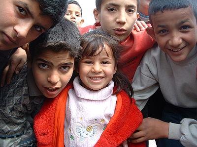 400px-Children_living_next_to_Daurra_Oil_Refinery_in_Iraq